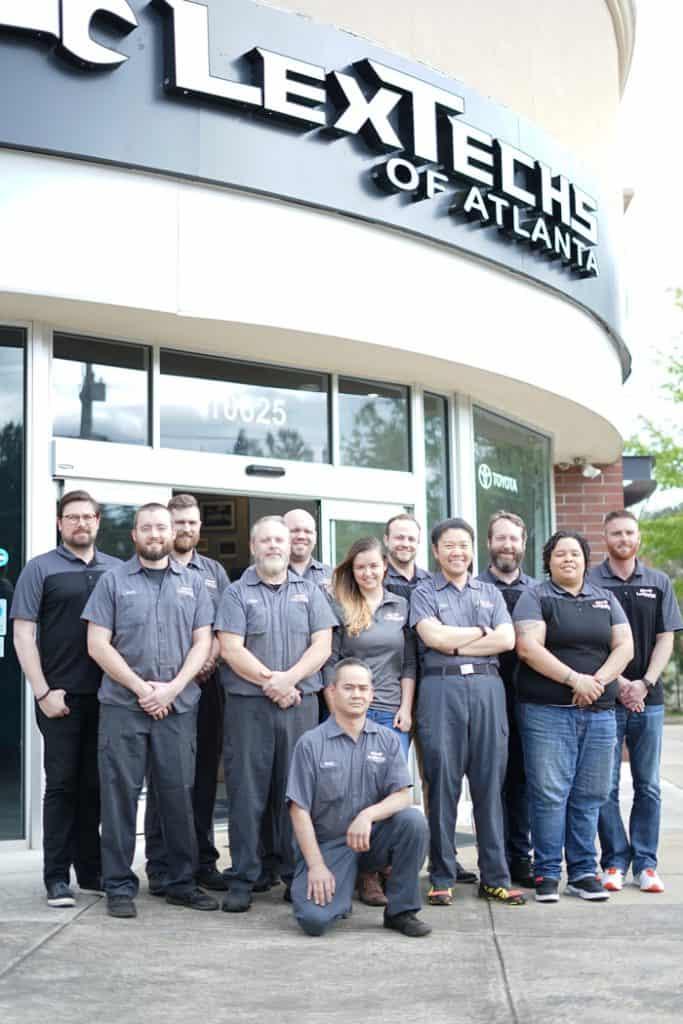 employees in front of LexTechs Of Atlanta repair shop